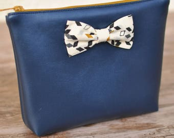 Metallic blue make-up and Twist Mustard Kit pouch