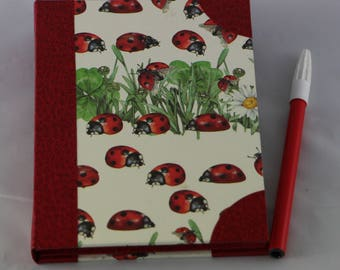 Wearing notebook refillable notebook made of cardboard covered with faux leather and paper fantasy (ladybugs)