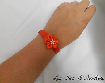 Bracelet made of satin orange with orange satin flower