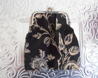 Flowers on black wallet