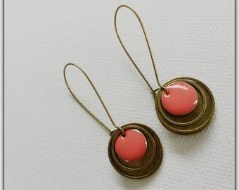 Bronze earrings and pink sequins