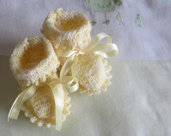 Speckled yellow baby booties