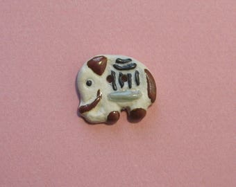 Ceramic button, 25 x 22 mm, elephant, 2 holes.