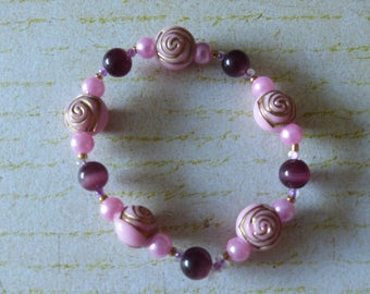 Elastic bracelet pink and purple beads