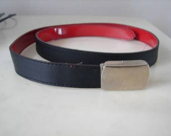 Belt 2 colors on one side and Red matte black Polish on the other