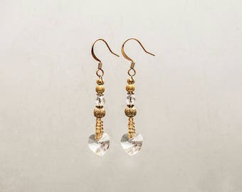 Stylish swarovski hearts dangling earrings with 22 carats gold plated ear hooks