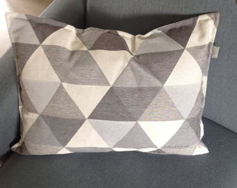 White and gray, rectangular cushion, triangular geometric patterns