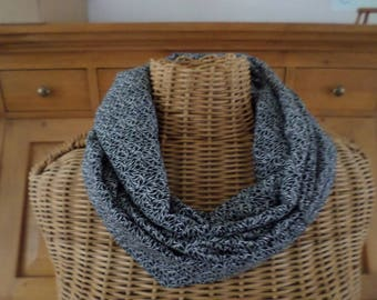 snood scarf black background with fine white leaves