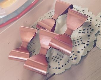 Rose gold bow push pins. (Set of 4.)