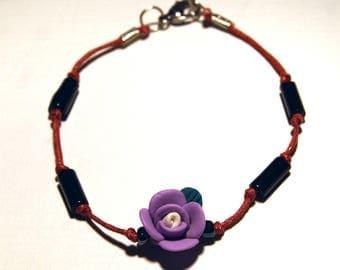 This bracelet, pink, black tones