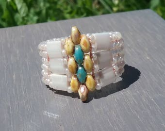 Beaded ring was hand made glass beads