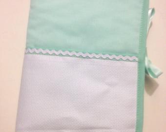 Health book has cross-stitch, seafoam green fabric 100% cotton.