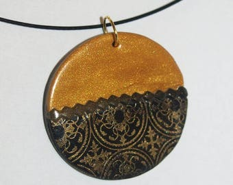 Round black and gold necklace with gold lace effect Christmas inspired