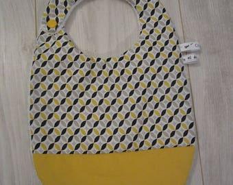 Yellow and black baby bib