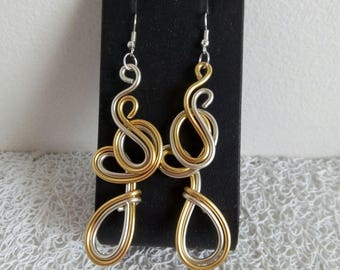 Silver and gold earrings.