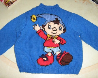 Blue sweater with jacquard knitted hand puppet