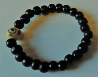 Emoticon pulling tongue and black wood beads