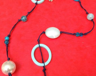 Necklace mix of blue beads on leather thread