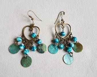 Beautiful earrings and metal beads