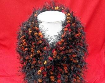 Fancy scarf black tassel red orange polyester