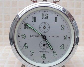 old alarm clock mechanical brand Bayard stentor orange from the 1960s