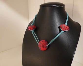 Necklace mid-length yurt red turquoise beaded sailor knot