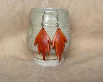 Large orange leaf leather earrings