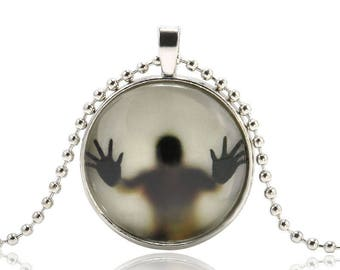 Man behind the glass, Glow in the dark, Glowing, Pendant. Necklace.