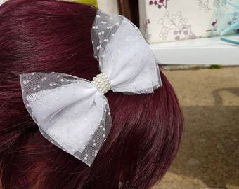 headband bow and pearls ceremony