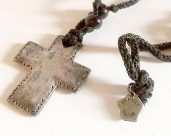 Cross pendant KOOKAI mounted on black cord and black beads