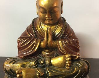 Living in the present. Golden Buddha.
