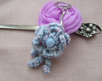 Keychain or bag charm is hand - crocheted, decorated with purple Pearl its delicate flower