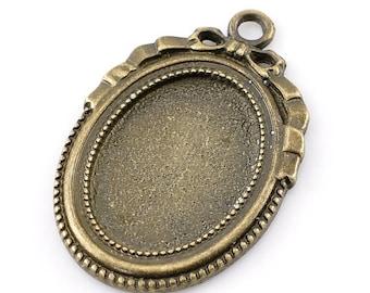 Pendant cabochon 18 x 25 cm, antique bronze color support.