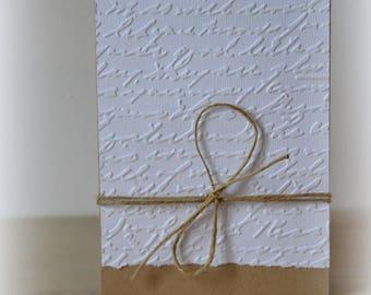 Handmade blank embossed writing is kraft card / envelope provided