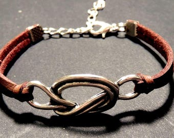 Tan colored, bow metal leather bracelet