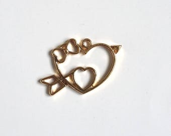Gold tone bow and heart pendant