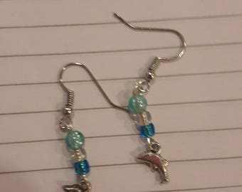Dolphin char with clear and blue beaded earrings