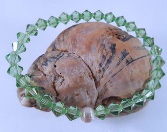Sparkling filigree bracelet with Swarovski ® crystals and a sterling silver bead