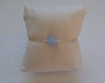 Azure Blue clover bracelet on silver chain.