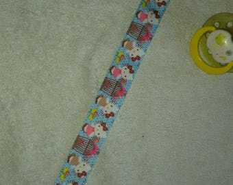 Hello Kitty pacifier clip blue yellow and pink