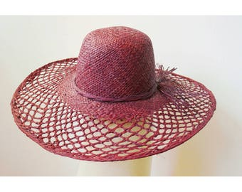 Sun Hat finely handwoven raffia with a bow on the side, chestnut brown color