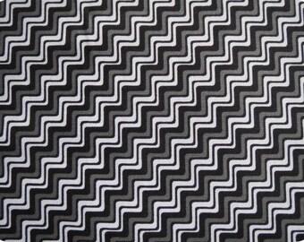 Tissu graphique blanc sur fond noir, largeur 110cm