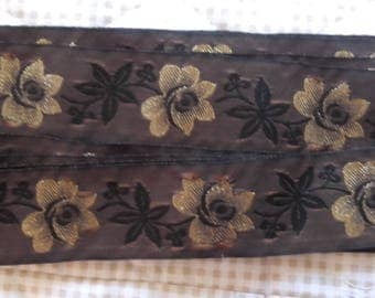 Ribbon weaved golden background by the yard sale Brown flowers