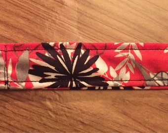 Coral, black, gray, and white lanyard