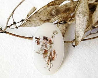 Brooch with watercolor herbarium