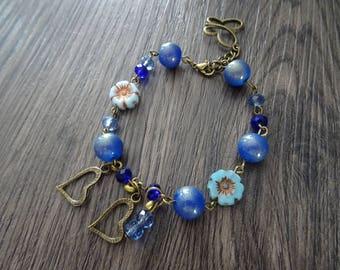Bracelet blue glass beads, glitter and tassel