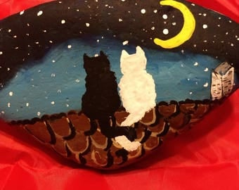 Two cats on a roof painted rock