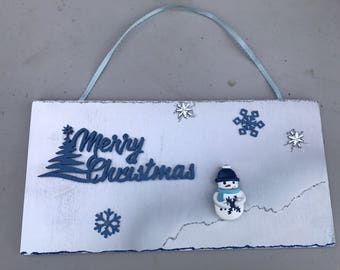 Merry Christmas sign with snowflakes, snowman