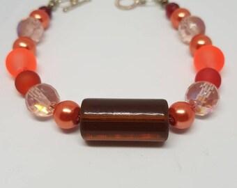 Handmade glass beaded bracelet large centre bead autumn colours naturegift idea  beaded bracelet