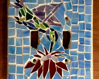 Mosaic switch plate with hummingbird and flower
